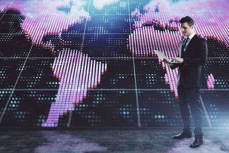 Businessman and world map hologram. Double exposure. Concept of international finance Stock Photo