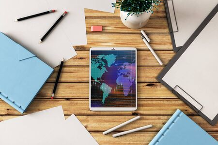 Digital tablet closeup top view with financial graph and partial world map on screen. Online international trading application concept. 3d rendering. Zdjęcie Seryjne - 129819674