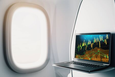Laptop closeup inside airplane with forex graph on screen. Financial market trading concept. 3d rendering. Zdjęcie Seryjne - 129819686