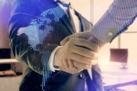 Multi exposure of world map on office background with two businessmen handshake. Concept of international business Zdjęcie Seryjne
