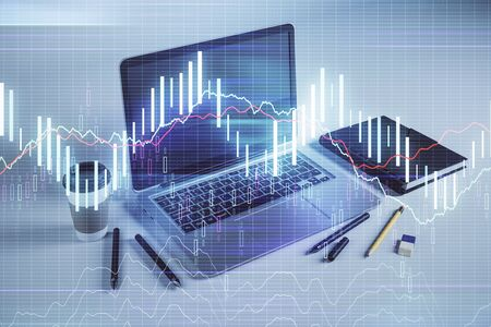 Forex graph hologram with desktop office computer background. Double exposure. Concept of financial analysis. Stok Fotoğraf - 129830114