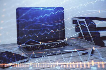 Stock market chart and desktop office computer background. Multi exposure. Concept of financial analysis. Фото со стока - 129830141