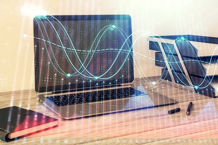 Stock market chart and desktop office computer background. Multi exposure. Concept of financial analysis. Фото со стока - 129830142