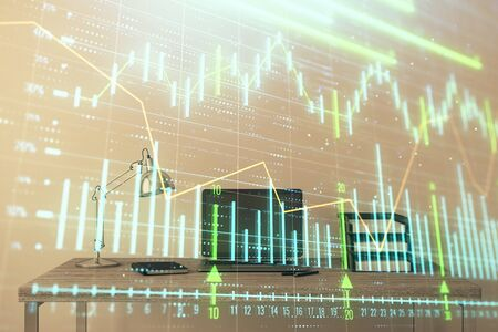 Stock market chart and desktop office computer background. Multi exposure. Concept of financial analysis. Фото со стока - 129830437