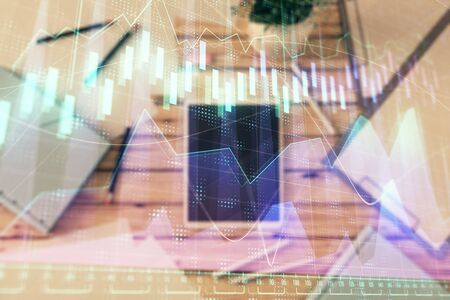 Double exposure of forex graph on digital tablet laying on table background. Concept of market analysis Stok Fotoğraf