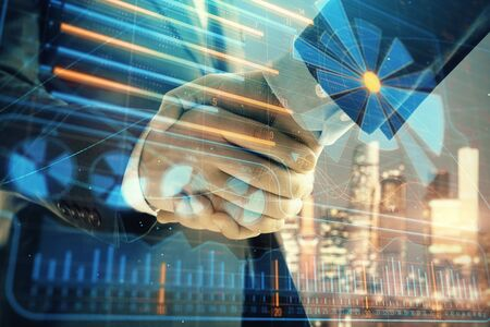 Double exposure of business theme drawing on cityscape background with handshake. Concept of partnership Фото со стока - 129830339