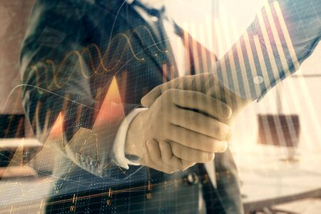 Multi exposure of financial graph on office background with two businessmen handshake. Concept of success in business Фото со стока - 129830350