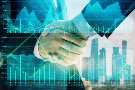 Double exposure of financial graph on cityscape background with two businessman handshake. Concept of stock market deal Фото со стока - 129830305