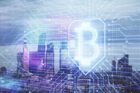 Double exposure of bitcoin sign drawing hologram on cityscape background. Concept of crypto economy Stock fotó