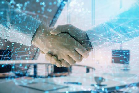 Multi exposure of tech theme hologram on office background with two men handshake. Concept of technology
