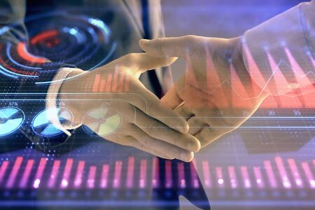 Multi exposure of business graph on abstract background with two men handshake. Concept of success