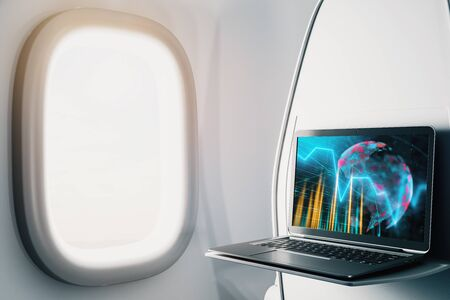 Laptop closeup inside airplane with forex graph and world map on screen. Financial market trading concept. 3d rendering. Stock fotó - 129987204