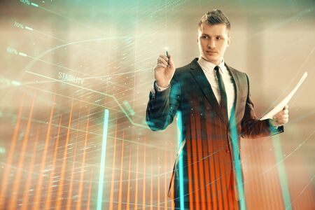 Businessman and forex graph hologram. Double exposure. Concept of financial education and analysis Stok Fotoğraf