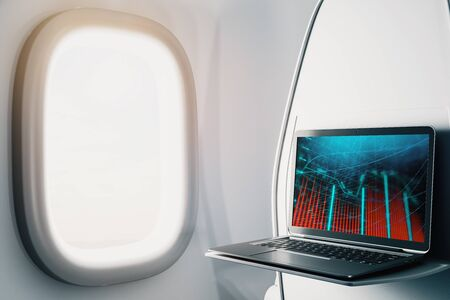 Laptop closeup inside airplane with forex graph on screen. Financial market trading concept. 3d rendering. Stock fotó - 129987381