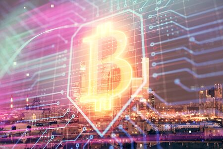 Double exposure of bitcoin sign drawing hologram on cityscape background. Concept of crypto economy Zdjęcie Seryjne