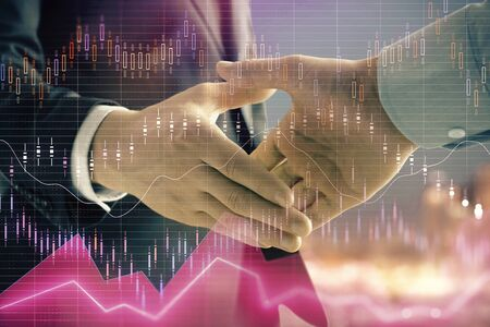 Double exposure of financial chart on cityscape background with two businessmen handshake. Concept of financial analysis and investment opportunities Stock Photo - 130141513