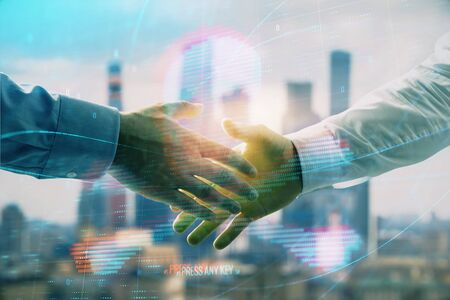 Multi exposure of digital crime theme hologram on city view background with two people handshake. Concept of securitization Stock Photo - 130141699