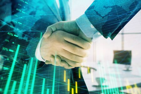 Multi exposure of financial chart and map on office background with two businessmen handshake. Concept of success in business Stock Photo - 130141733