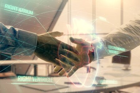 Multi exposure of heart icon hologram on office background with two men handshake. Concept of medical education Stock Photo - 130142774