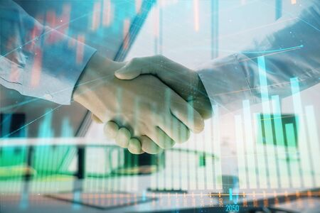 Multi exposure of financial graph on office background with two businessmen handshake. Concept of success in business Stock Photo - 130142810