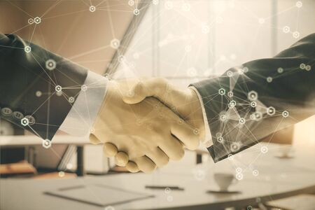 Multi exposure of tech theme hologram on office background with two men handshake. Concept of technology Stock Photo - 130142914