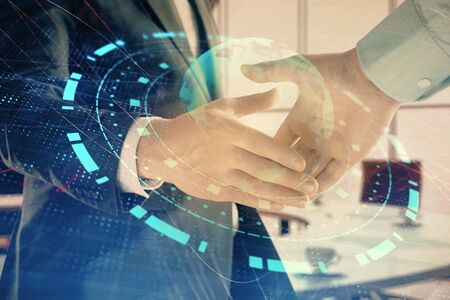 Multi exposure of world map on office background with two businessmen handshake. Concept of international business Stockfoto