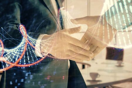 Multi exposure of DNA icon hologram on office background with two men handshake. Concept of education