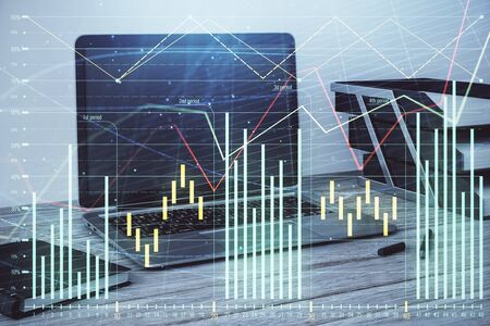 Stock market chart and desktop office computer background. Multi exposure. Concept of financial analysis. Stock fotó - 130681751