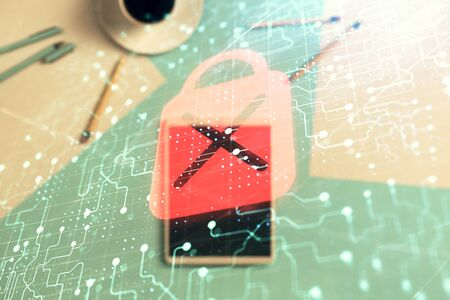 Double exposure of lock icon drawing on digital tablet, table background. Concept of data securitization 版權商用圖片