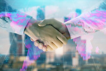 Double exposure of world map on cityscape background with two businessmen handshake. Concept of international business Stock Photo