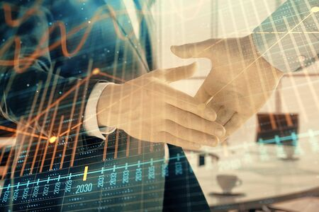 Multi exposure of financial graph on office background with two businessmen handshake. Concept of success in business Stock Photo