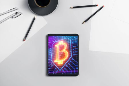 Digital tablet closeup with bitcoin theme picture on screen. Blockchain technology concept. 3d rendering.