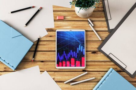 Digital tablet closeup top view with financial graph on screen. Online trading application concept. 3d rendering. 版權商用圖片