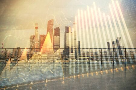 Forex graph hologram with city view from roof background. Double exposure. Financial analysis concept. Фото со стока