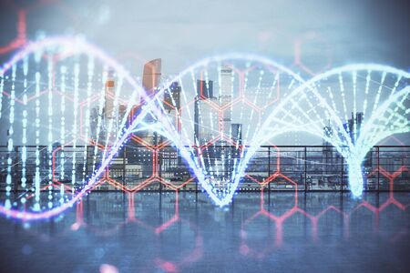 DNA hologram with city view from roof top background. Double exposure. Education concept.