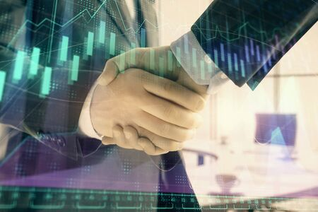 Multi exposure of financial graph on office background with two businessmen handshake. Concept of success in business Stok Fotoğraf