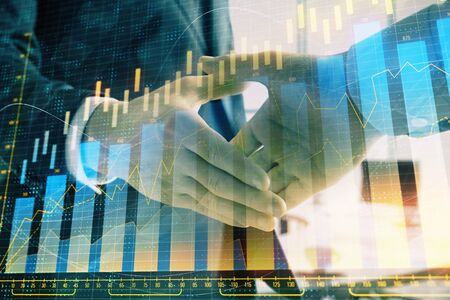 Multi exposure of financial graph on office background with two businessmen handshake. Concept of success in business Stockfoto