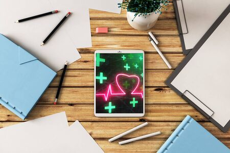 Digital tablet closeup top view with human heart drawing on screen. Medical education concept. 3d rendering. Stok Fotoğraf