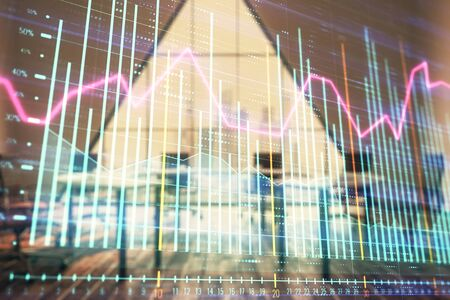Double exposure of forex chart on conference room background. Concept of stock market analysis 스톡 콘텐츠