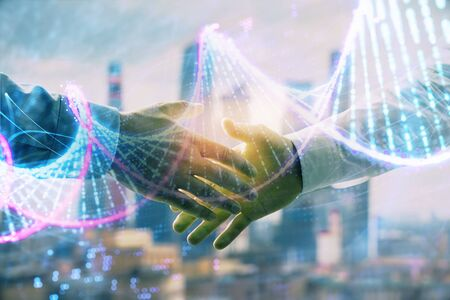 Multi exposure of DNA drawing hologram on city view background with handshake. Concept of education