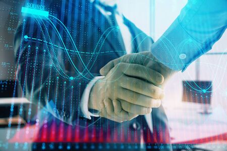 Multi exposure of financial graph on office background with two businessmen handshake. Concept of success in business 스톡 콘텐츠
