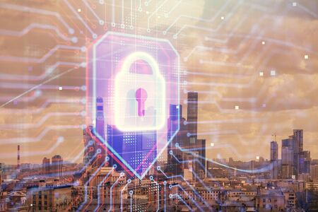 Double exposure of lock icon hologram on cityscape background. Concept of data security