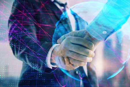 Double exposure of world map on cityscape background with two businessmen handshake. Concept of international business Zdjęcie Seryjne