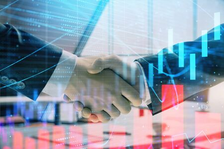 Multi exposure of financial graph on office background with two businessmen handshake. Concept of success in business Zdjęcie Seryjne