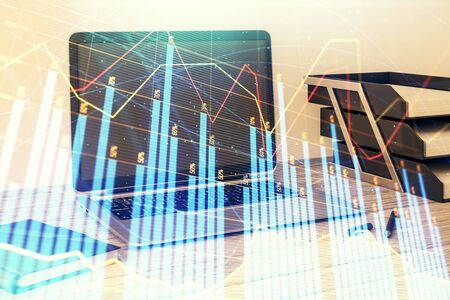 Stock market chart and desktop office computer background. Multi exposure. Concept of financial analysis.
