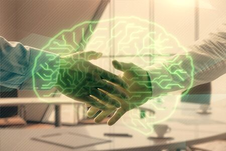 Double exposure of brain drawing on office background with two men handshake. Concept of innovation Stock Photo