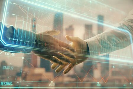 Double exposure of business theme drawing on cityscape background with handshake. Concept of partnership Stock Photo