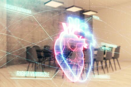 Double exposure of heart hologram on conference room background. Concept of medical education
