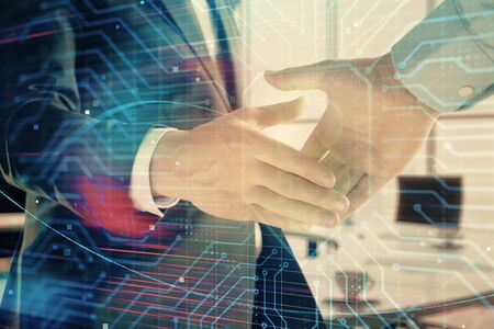 Double exposure of blockchain theme drawing on office background with two businessmen handshake. Concept of crypto economy