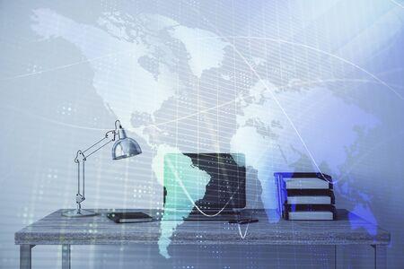 Map hologram and desktop office computer background. Multi exposure. Concept of international business Stok Fotoğraf